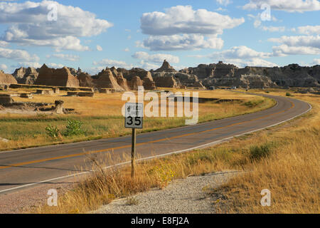 Road through Badlands National Park, South Dakota, United States - Stock Photo