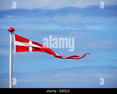 Danish pennant flag against partly cloudy sky, Denmark - Stock Photo