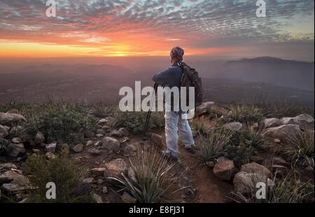 Man looking at view at sunset, Cleveland National Forest, California, America, USA - Stock Photo