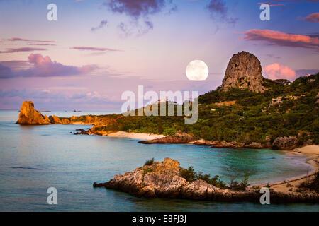 Moon over coastal landscape, okinawa, japan - Stock Photo