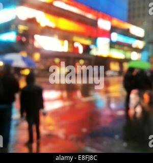 Abstract urban street scene at night, Manhattan, New York, America, USA - Stock Photo