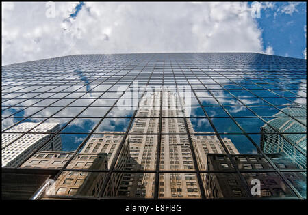 Chrysler building and skyscraper reflections in glass building, New York, america, USA - Stock Photo