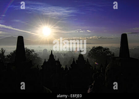 Indonesia, Central Java, Magelang, Silhouette of Borobudur Temple, 9th century - Stock Photo