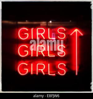 Netherlands, North Holland, Amsterdam, Orange neon 'girls' - Stock Photo