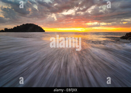 Indonesia, Padang, Taplau Beach, Wave and sunset - Stock Photo