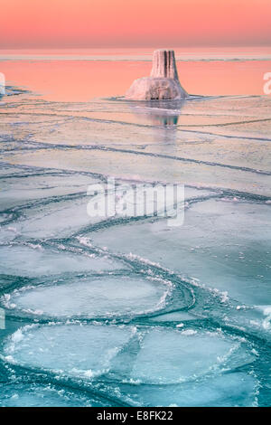 Sunset over frozen lake, Lake Michigan, Chicago, Illinois, America, USA - Stock Photo