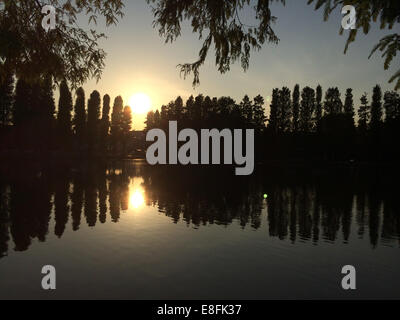 Sunset Reflections In Lake - Stock Photo