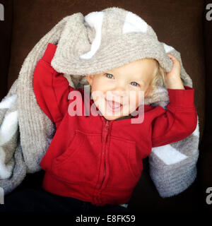 Portrait of a boy with a blanket on his head - Stock Photo