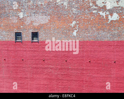 Brick wall with peeling paint - Stock Photo