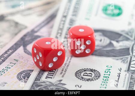 Pair Of Dice On Us Dollars - Stock Photo