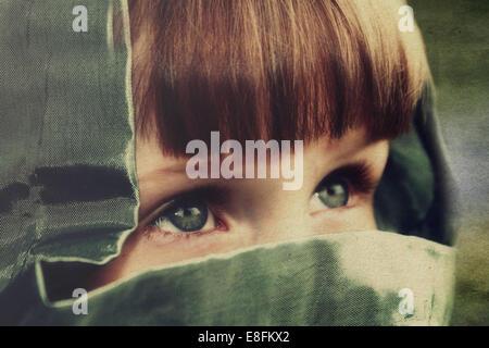 Close-up of girl wearing hood - Stock Photo