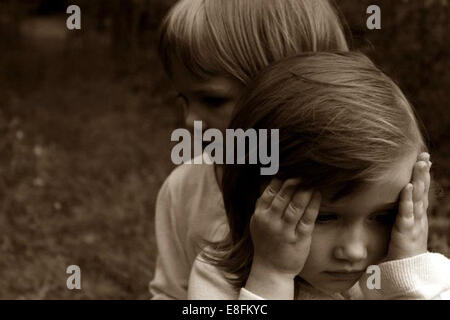Portrait of two girls in the woods - Stock Photo