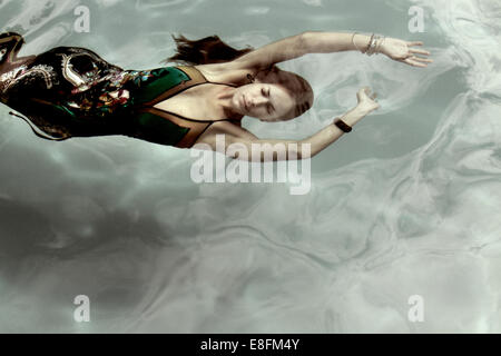 Woman In A Dress Underwater - Stock Photo