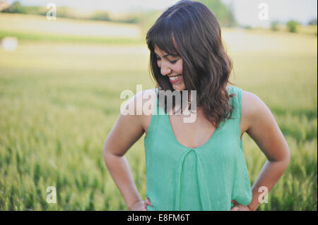 Piemonte, Italy Smiling Girl Dressed In Green In A Field - Stock Photo