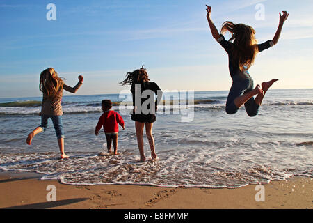 Four girls messing about on the beach, Barcelona, Spain - Stock Photo