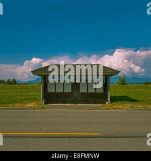 View of bus stop and mail boxes - Stock Photo