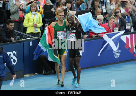 Nijel Amos (BOT) wins the Gold Medal and celebrates with Andre Olivier (RSA) who won the bronze medal - Mens 800m - Stock Photo