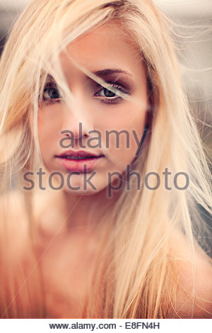 Portrait of a beautiful blonde woman with messy hair - Stock Photo