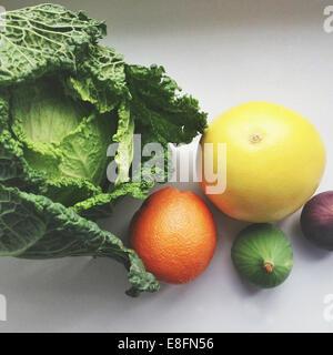 Orange, grapefruit, figs and cabbage - Stock Photo
