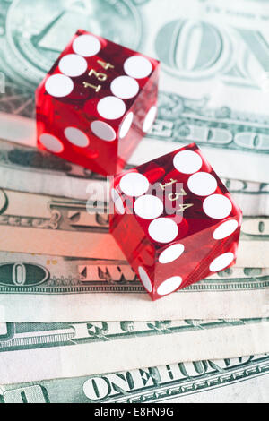 Two Dice on US banknotes - Stock Photo