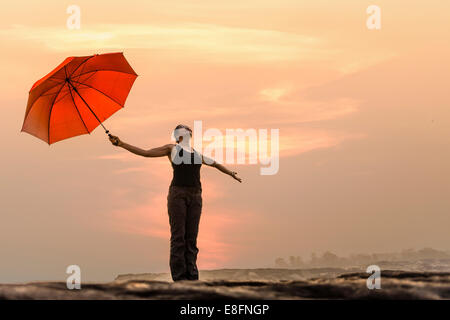 Thailand, Woman enjoying nature - Stock Photo