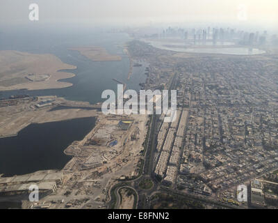 United Arab Emirates, Dubai, Aerial view of construction site and skyscrapers in background - Stock Photo