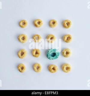 Close-up of circular breakfast cereal in a row - Stock Photo
