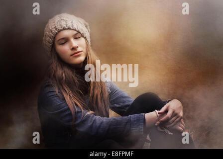 Teenage girl day dreaming - Stock Photo