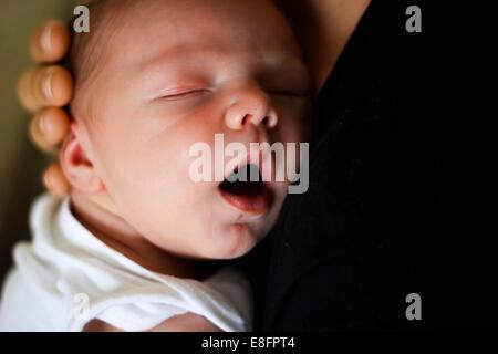 Mother holding newborn baby boy - Stock Photo