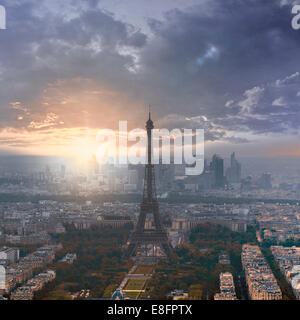 Eiffel Tower at sunset with La Defense in the distance, Paris, France - Stock Photo