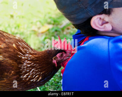 Cute chicken being friendly - Stock Photo