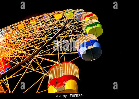 Australia, Sydney, Low angle view of Ferris Wheel At Night in Luna Park - Stock Photo