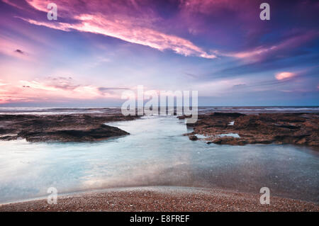 Israel, Tel Aviv District, Tel Aviv, Sunset on Beach - Stock Photo