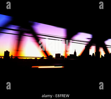 USA, New York City, Manhattan, Colored bridge and city skyline - Stock Photo