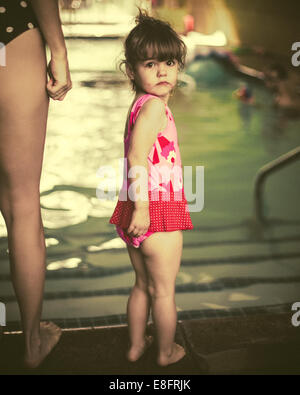 Girl (18-23 months) at swimming baths with her mother - Stock Photo