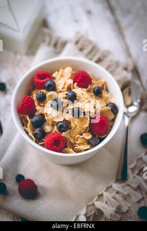 Cornflakes with blueberries and raspberries - Stock Photo