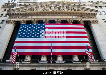 USA, New York City, Close up of New York Stock Exchange's facade with american flag - Stock Photo