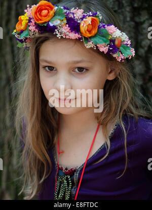 Girl wearing garland of flowers on head - Stock Photo