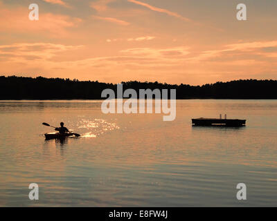 USA, New York State, Sullivan, Kayaking at sunset - Stock Photo