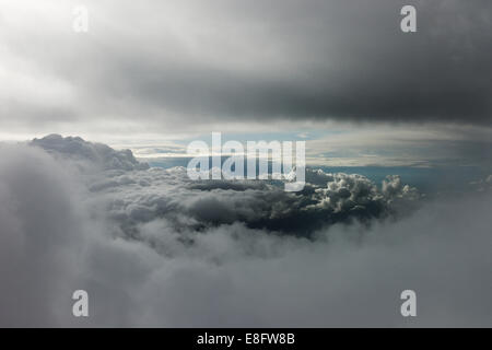 Gap in stormy cumulonimbus clouds showing bright sky - Stock Photo