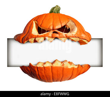 Halloween blank sign as a pumpkin character with human expression biting into and holding a blank banner with jack - Stock Photo