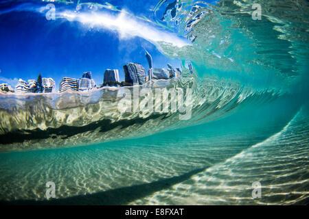 Australia, Gold Coast, City view through wave - Stock Photo