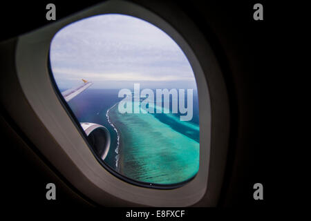 Maldives, Tropical islands seen from plane window - Stock Photo