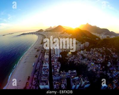 Brazil, Rio de Janeiro, Aerial view of Copacabana Beach at sunset - Stock Photo