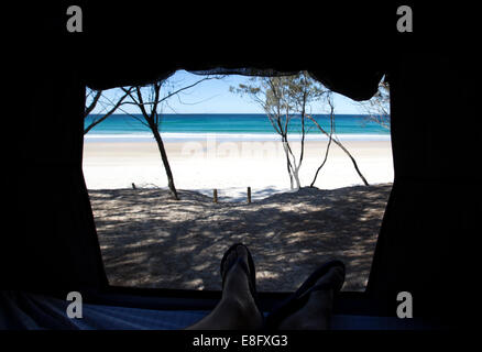 View of beach from inside a tent - Stock Photo