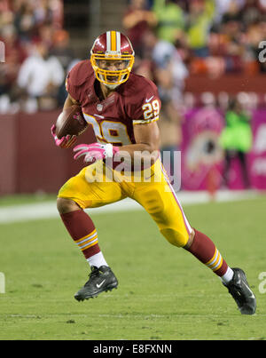 Landover, Maryland, USA. 06th Oct, 2014. Washington Redskins running back Roy Helu, Jr. (29) carries the ball after - Stock Photo