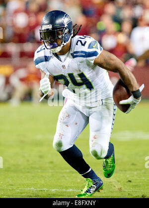 Landover, Maryland, USA. 06th Oct, 2014. Seattle Seahawks running back Marshawn Lynch (24) carries the ball late - Stock Photo