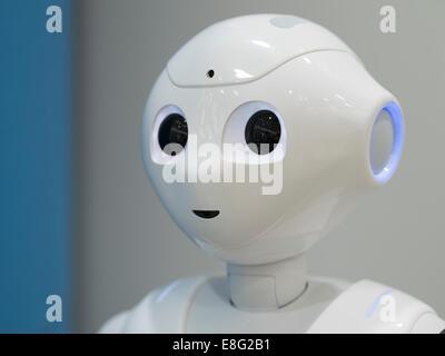 Pepper a humanoid robot by Aldebaran Robotics and SoftBank Mobile. At the Aoyama Softbank Store, Tokyo, Japan. - Stock Photo