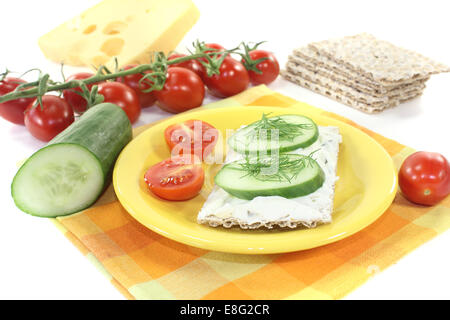 Crispbread with cream cheese on a bright background - Stock Photo