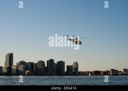 New York City Police Department Harbor Unit helicopter on the Hudson River in New York Harbor New York USA - Stock Photo